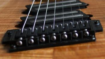 Electric Guitars Bridge Design