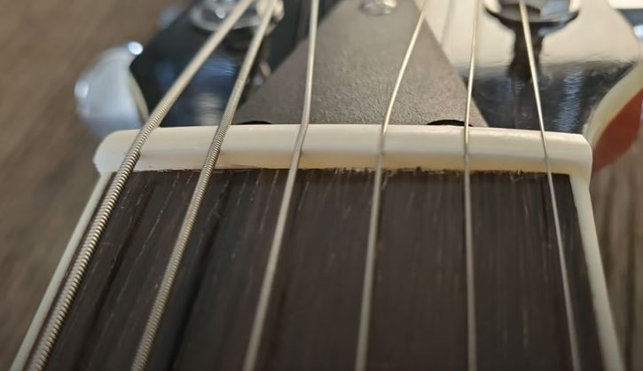 Bone Nut Construction and strings closeup